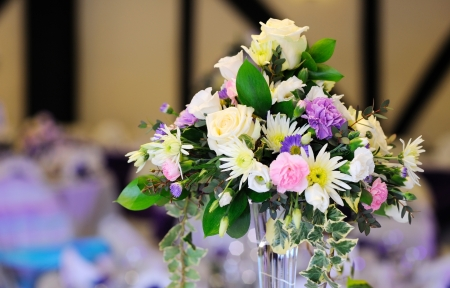 Flowers decorate table at wedding reception photo