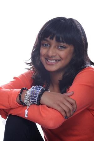 indian style sitting: Young asian girl wearing orange Stock Photo