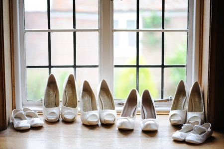 bridesmaids: Bride and bridesmaids shoes in window Stock Photo