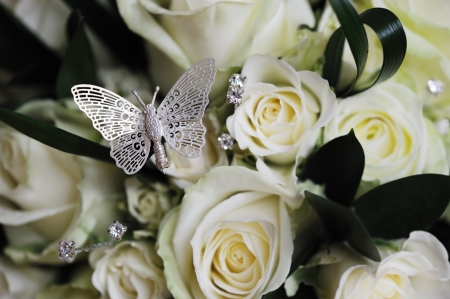 Brides bouquet closeup with butterfly detail photo