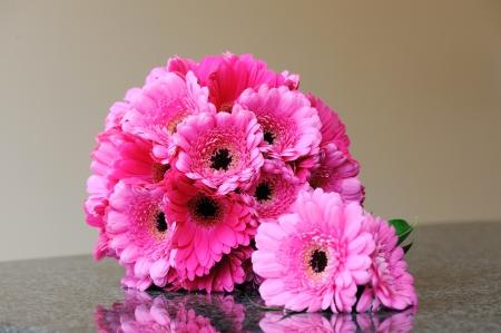 buttonhole: Brides pink bouquet and grooms buttonhole Stock Photo