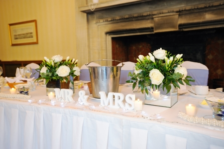 Top table at wedding reception showing mr & mrs decoration