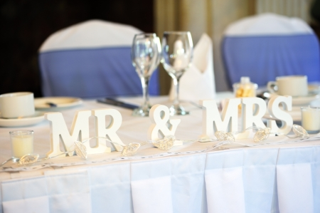 Mr & Mrs decoration on wedding reception table photo