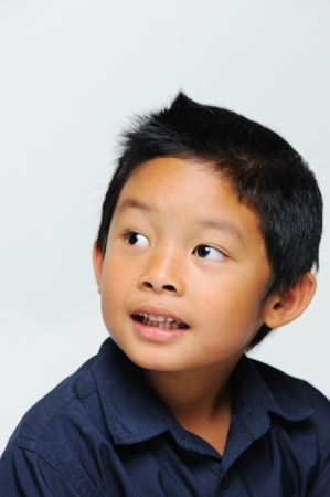 Cute asian boy looking away and smiling photo