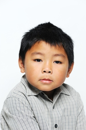 filipino people: Asian boy looking serious wearing smart shirt Stock Photo