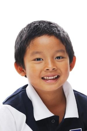 Asian boy looking at camera and looking happy Standard-Bild