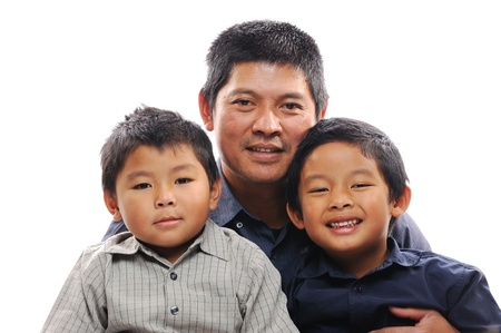Asian father cuddles sons looking happy photo