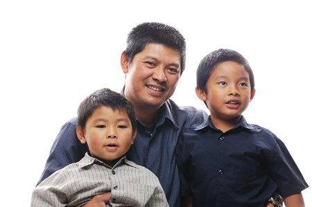 Smiling asian father with two sons photo