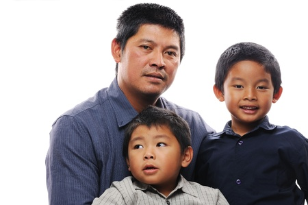Asian father hugs his two sons Stock Photo - 14741868