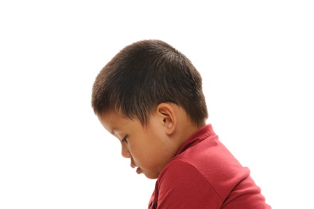 Asian boy looking sad profile view with red shirt