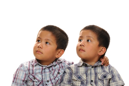 Asian twin brothers looking up and away photo