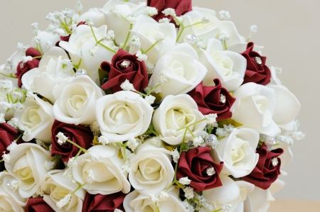 Brides artificial bouquet of flowers photo