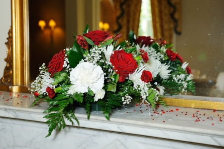 Red roses decorate wedding reception photo