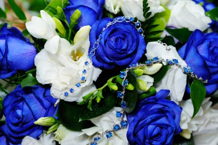 Brides blue rose bouquet and blue gem bracelets photo