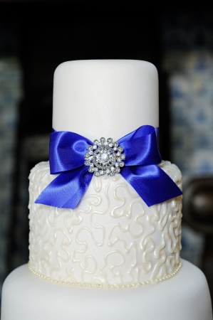 Closeup of blue and white wedding cake at reception