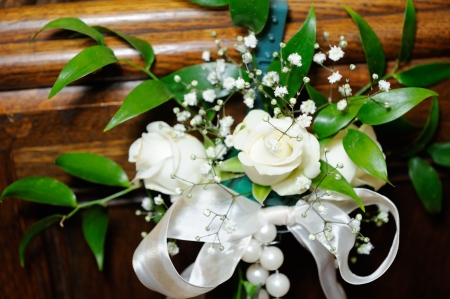 White roses decorate inside of church on wedding day stock photo white roses decorate inside of a church on wedding day photo junglespirit Image collections