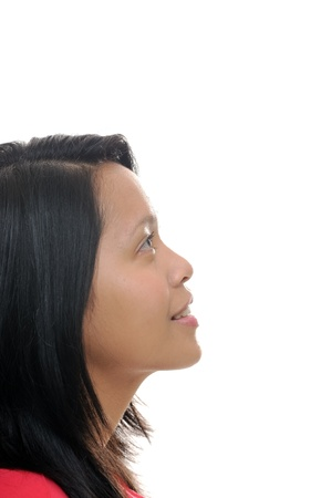 woman profile face: Asian girl looking up into white space