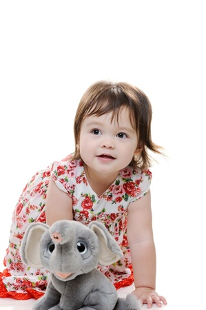 Young female toddler with fluffy toy