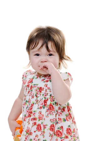 child crying: Triste niña littler llorando y mirando molesto