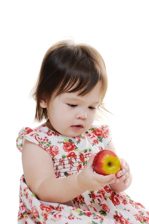 Young infant girl holding an apple