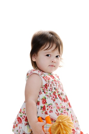quizzical: Young female toddler looks cute and quizzical