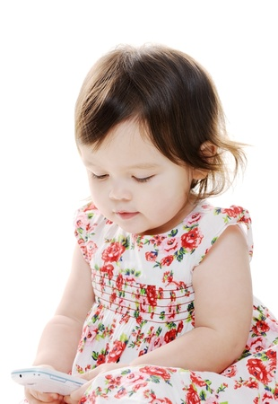 Closeup portrait of little girl texting photo