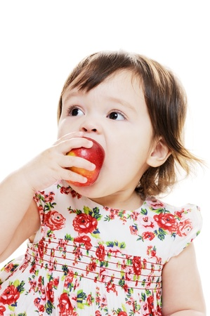young girl biting an apple closeup portrait photo