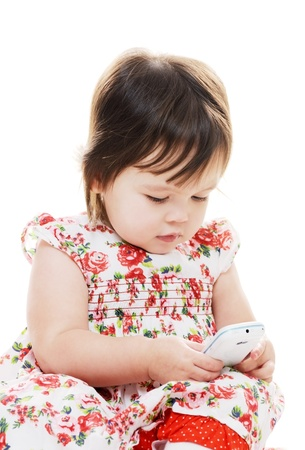 Young female girl texting on mobile phone photo