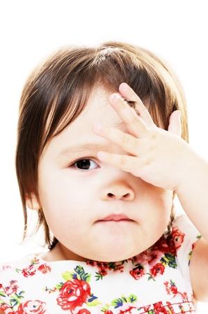 peek a boo: Infant girl looks like she did big mistake closeup portrait