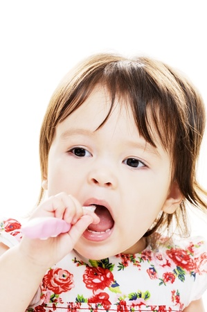 Young girl enjoys brushing her teeth closeup portrait photo