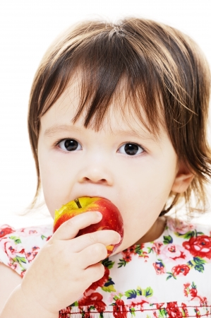 Young girl taking bite from big red apple Stock Photo - 17668137