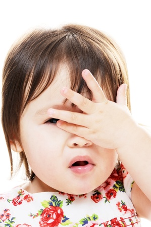 Little girl with hand on face closeup portrait Standard-Bild