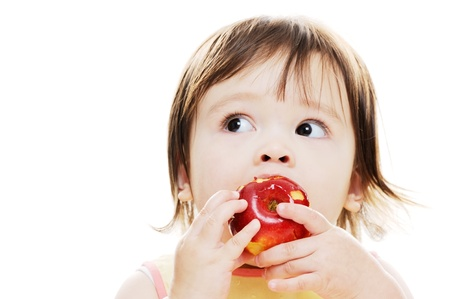 asian toddler: Young girl enjoying a fresh red apple