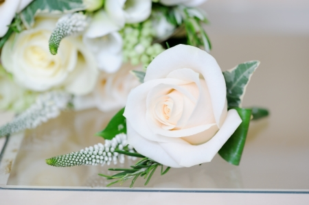 buttonhole: Wedding day, grooms buttonhole flower closeup is white rose Stock Photo