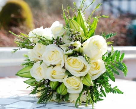 floral arrangement: Closeup of brides bunch of white roses on wedding day