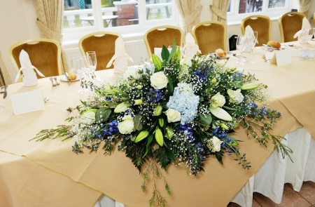 Closeup detail of flower arrangement at wedding reception photo