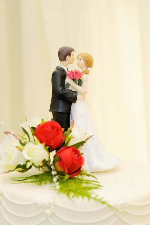 Wedding cake closeup shows topper of bride and groom Stock Photo - 19356266