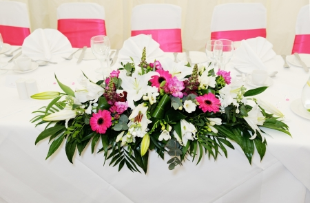 Closeup of wedding reception flower arrangement is pink and white