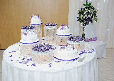 Big white and purple asian wedding cake at reception photo