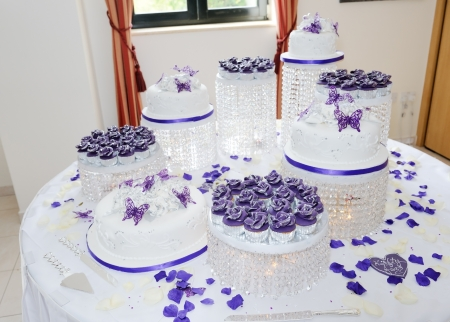 Massive white and purple asian wedding cake at reception photo