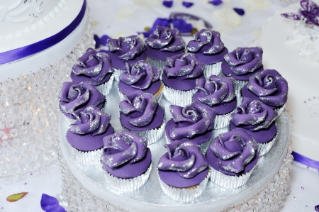 Purple or violet cup cakes at wedding reception closeup detail photo