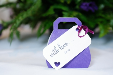 favours: Closeup of violet wedding favours gift at wedding reception