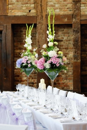Wedding reception flower arrangement with pink and white decoration on table