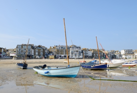 Lots of small boats on the beach at low tide in St Ives, Cornwall