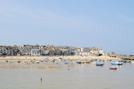 St Ives in Cornwall in the summer on a sunny day showing the beach and boats photo