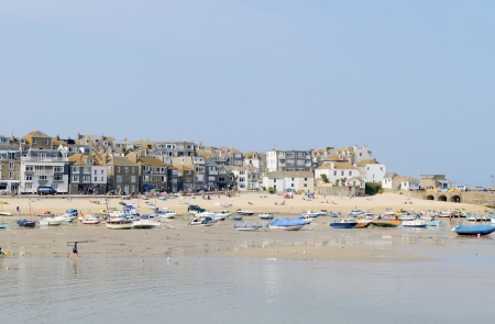 St Ives in Cornwall on s sunny summers day showing the beach with fishing boats photo