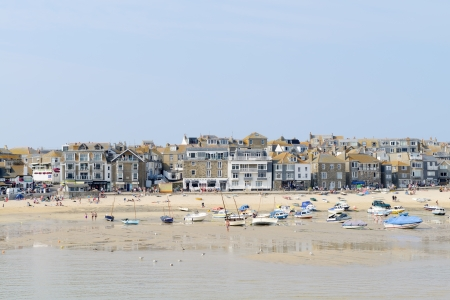St Ives in Cornwall on a sunny day during the summer showing fishing boats and beach photo