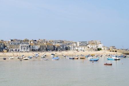 Fishing boats in harbour on a sunny day in St Ives, Cornwall  photo