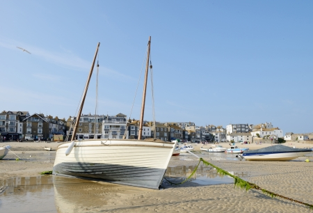 Closeup of traditional fishing boat on the sandy beach in St Ives Cornwall on a sunny summer day photo