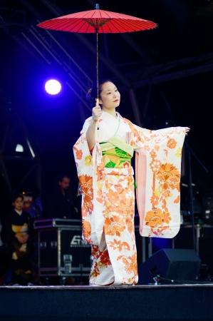 London, England - October 5, 2013  Japanese girl wearing traditional costume of kimono on stage at matsuri festival